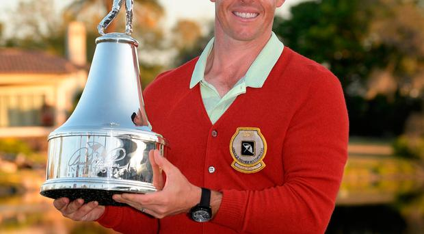 Rory McIlroy holds the championship trophy after winning the Arnold Palmer Invitational