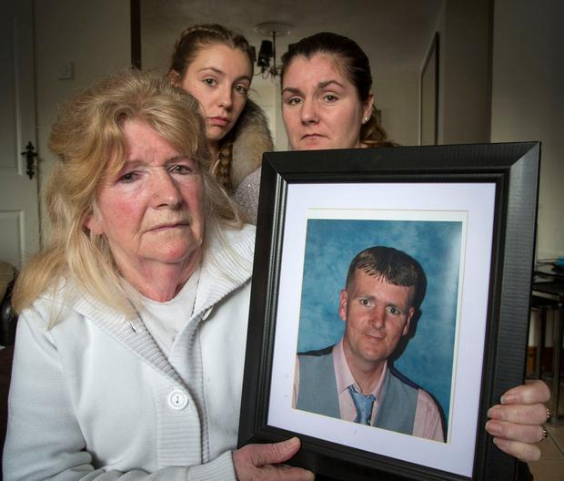 Margaret Mooney, pictured holding a photo of her deceased son Wesley, with daughter Jolene (rt) and niece Jemma (ctr) at their Finglas home yesterday.