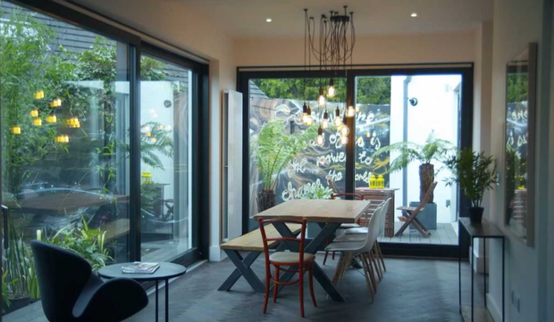 The dining space looks out onto the graffiti wall and courtyard. Photo: RTE