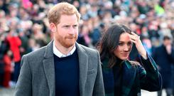 Britain's Prince Harry and his fiancée, US actress Meghan Markle walk into Edinburgh Castle, during a visit to Scotland on February 13, 2018. / AFP PHOTO / POOL / Jane Barlow (Photo credit should read JANE BARLOW/AFP/Getty Images)
