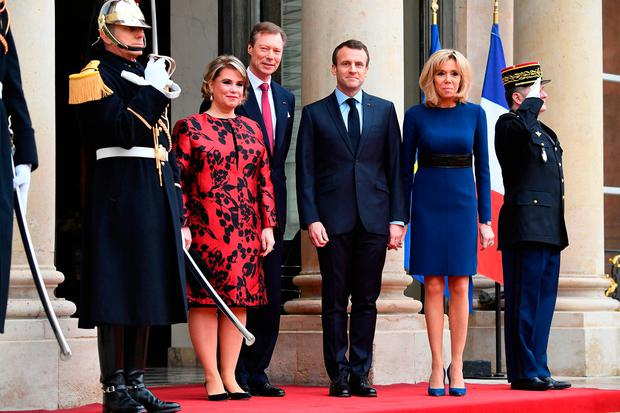 (L-R) Maria Teresa, Grand Duchess of Luxembourg, Henri, Grand Duke of Luxembourg, French President Emmanuel Macron and Brigitte Macron pose in the courtyard of Elysee Palace on March 19, 2018 in Paris, France. Grand-Duke Henri Of Luxembourg and Grand-Duchess Maria Teresa Of Luxembourg attend a three days state visit to France. (Photo by Pascal Le Segretain/Getty Images)