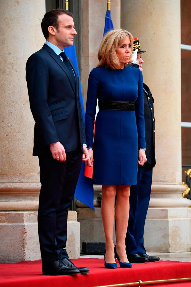 (L-R) French President Emmanuel Macron and Brigitte Macron pose in the courtyard of Elysee Palace on March 19, 2018 in Paris, France. Grand-Duke Henri Of Luxembourg and Grand-Duchess Maria Teresa Of Luxembourg attend a three days state visit to France. (Photo by Pascal Le Segretain/Getty Images)