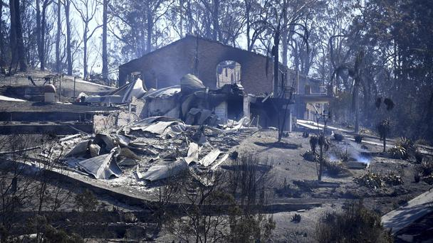 Debris from a destroyed home in town of Tathra (AAP/AP)