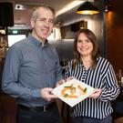 Gin sync: Bistro 41 owners James and Laura Kelly with their Drumshanbo Gunpowder cured gin salmon dish. Photo: Liam Burke/Press 22