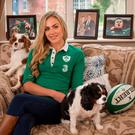 CJ Stander's wife Jean-Marie Neethling puts her feet up at home with the couple's dogs. Photo: Mark Condren
