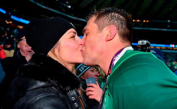 CJ Stander kisses wife Jean-Marie in the stands at Twickenham after winning the Grand Slam. Photo: Ramsey Cardy/Sportsfile