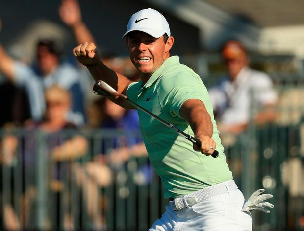 Rory McIlroy celebrates his birdie putt on the 18th hole of the Arnold Palmer. Photo: Mike Ehrmann/Getty