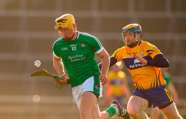 Tom Morrissey of Limerick in action against Seadna Morey of Clare. Photo: Diarmuid Greene/Sportsfile