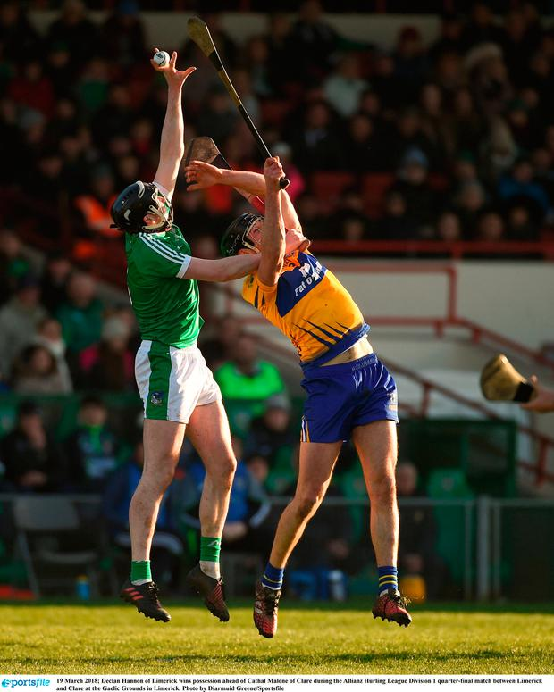 Declan Hannon of Limerick wins possession ahead of Cathal Malone of Clare. Photo: Diarmuid Greene/Sportsfile