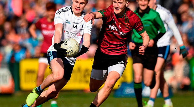 Cormac Murphy of St. Mary's Grammar in action against Jack Haddock of St.Ronan's College. Photo: Philip Fitzpatrick/Sportsfile