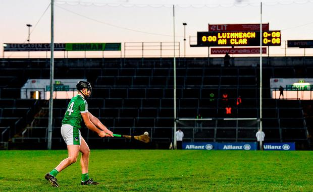 Colin Ryan scores the winning point for Limerick during sudden death in the free-taking competition after yesterday's league quarter-final against Clare. Photo: Diarmuid Greene/Sportsfile