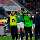 Keith Earls of Ireland is assisted by team doctor Dr. Ciaran Cosgrave and Dave Revins to a stretcher