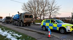 A vehicle of interest wrapped in blue tarpaulin is removed from Larkhill Road in Durrington, Salisbury, on the back of an Army lorry, as the investigation into the suspected nerve agent attack on Russian double agent Sergei Skripal and his daughter Yulia continues. Picture: Ben Birchall/PA Wire