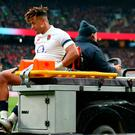 England's Anthony Watson goes off injured against Ireland