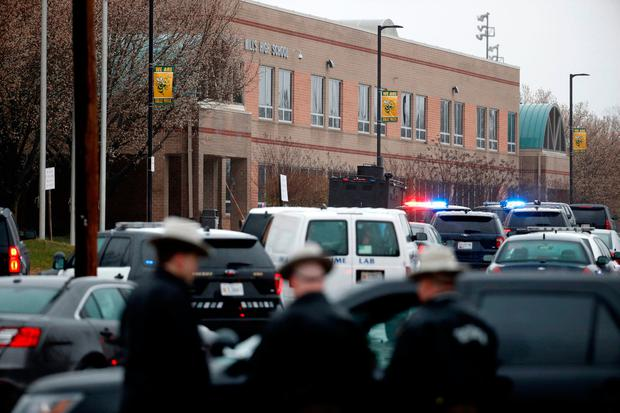 Deputies and federal agents converge on Great Mills High School, the scene of a shooting, Tuesday morning, March 20, 2018 in Great Mills, Md. The shooting left at least three people injured including the shooter. Authorities said the situation is