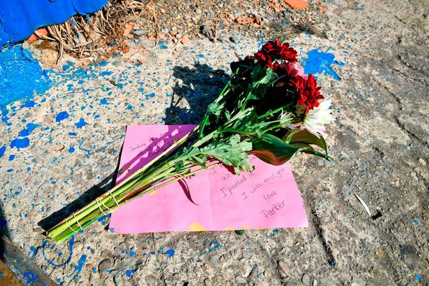 Flowers left beside a slipway leading to the River Teifi in Cardigan, Wales, near the scene where two-year-old Kiara Moore was recovered from a car that had plunged into the river. Ben Birchall/PA Wire