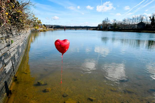 A red balloon in the River Teifi in Cardigan, Wales, near the scene where two-year-old Kiara Moore was recovered from a car that had plunged into the river. Ben Birchall/PA Wire