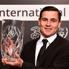 Josh Cullen with his U 21 Player of the Year award. Photo: Sportsfile