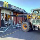 Thieves used this digger to try to remove the safe from the McDonald's outlet in Castletroy, Limerick. Photo: Press 22