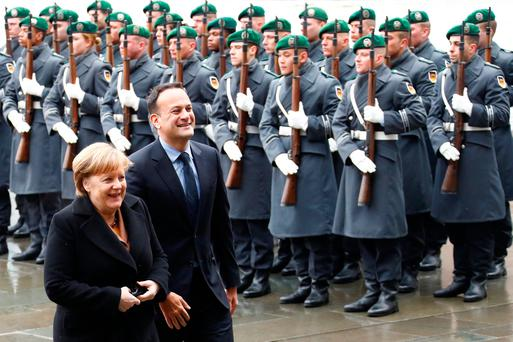 German Chancellor Angela Merkel and Taoiseach Leo Varadkar review the guard of honour at the Chancellery in Berlin. Photo: REUTERS