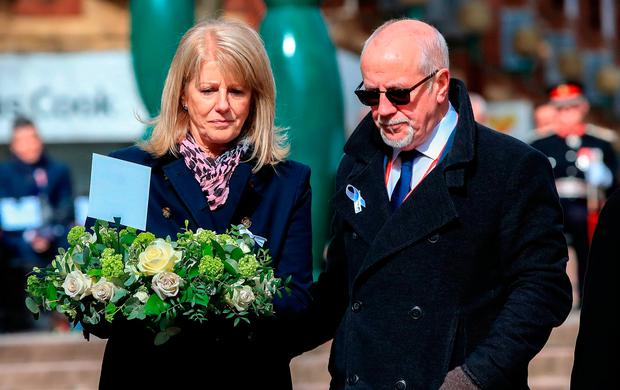 Wendy and Colin Parry lay flowers at a 25th anniversary service for the victims of the Warrington bombing, who included their son Tim. Photo: PA