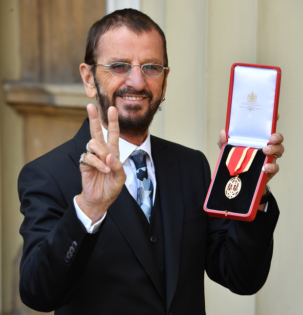 Ringo Starr poses after receiving his knighthood at Buckingham Palace in London yesterday. Photo: Reuters