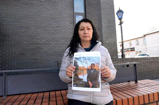 Valclecia Trindade, from Brazil, with a photo of her missing son Caique Trindade de Oliveira at Clondalkin Garda Station, Dublin. Picture: Caroline Quinn