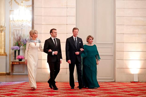 French President Emmanuel Macron, his wife Brigitte Macron, Grand Duke of Luxembourg Henri and his wife Maria Teresa, Grand Duchess of Luxembourg, arrive to a State dinner held at the Elysee Palace in Paris, France March 19, 2018. REUTERS/Benoit Tessier/Pool