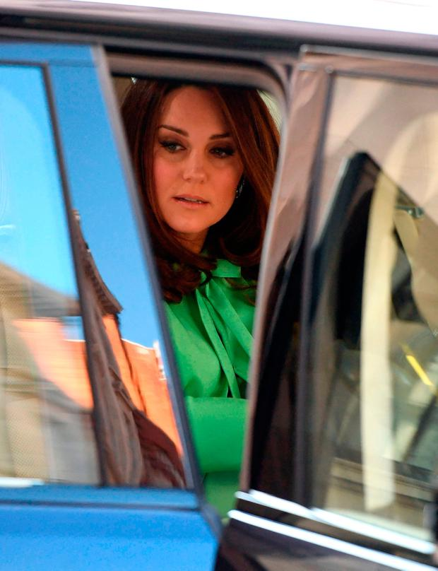 The Duchess of Cambridge arrives for a symposium of leading academics and charities championing early intervention into the lives of children at the Royal Society of Medicine in London