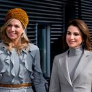 Jordan's Queen Rania, right, and Dutch Queen Maxima pose for photographers when arriving for a visit to the Mondriaan ROC school, a regional education center in The Hague, Netherlands, Wednesday, March 21, 2018. (AP Photo/Peter Dejong)
