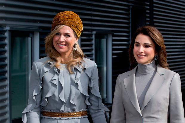 5bcded1dbb4 Jordan's Queen Rania, right, and Dutch Queen Maxima pose for photographers  when arriving for