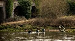 Garda divers conduct a line search along the River Suir as they hunt for schoolgirl Elisha Gault, who has been missing from her home in Carrick-on-Suir since St Patrick's Day. Photo: Doug O'Connor