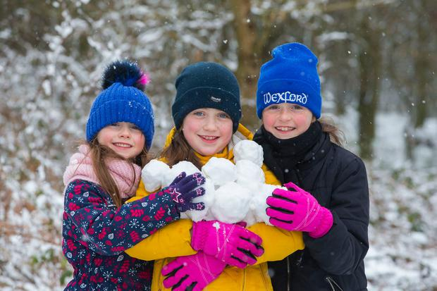 Sisters Leah, Aimee and Keelin Gallagher, from Wellington Bridge, Co Wexford, made the most of the recent snowy conditions. Photo: Patrick Browne