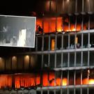 A fire at the Metro Hotel near Dublin Airport while (inset) image from Dublin Fire Brigade shows damage caused to inside of the building Picture: Niall Carson/PA Wire/Dublin Fire Brigade