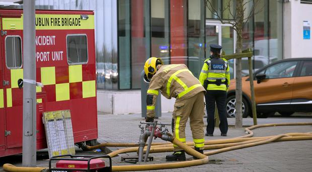 A fireman at the scene in Ballymun this morning in the aftermath of the fire in The Metro Hotel. Photo: Tony Gavin 22/3/201