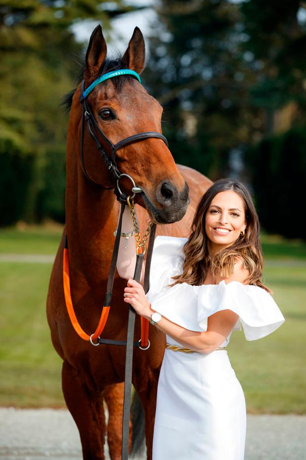 Olivia Wayne was joined by famed racehorse and poser Westerner Son at the announcement of her role as judge for this year's Carton House Most Stylish Lady competition. Photo: Andres Poveda
