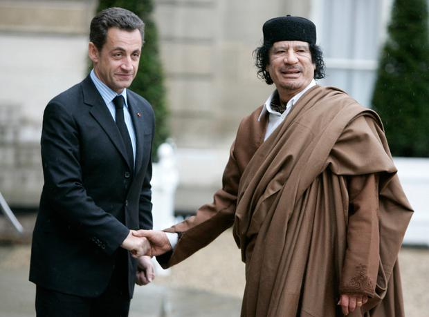 Then French president Nicolas Sarkozy, left, greets Libyan leader Muammar Gaddafi in 2007. Photo: AP