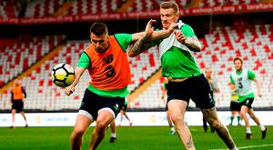 Seamus Coleman battles to get the better of James McClean. Photo: Stephen McCarthy/Sportsfile