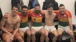 Daniel St Ledger posted a picture from the dressing room of Carlow players celebrating their promotion