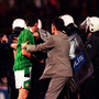 Ireland's Tony Cascarino is caught up in the centre of the pitch with riot police at the end of the game. Turkey v Ireland, European Championship soccer, Qualifier Play-off, second leg, Ataturk Stadium, Bursa, Turkey. Picture credit; Brendan Moran/SPORTSFILE