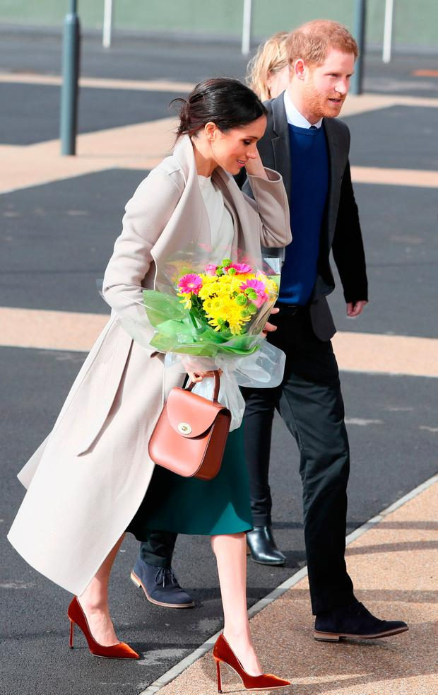 Prince Harry and Meghan Markle arrive for a visit to the Eikon Exhibition Centre in Lisburn where they attended an event to mark the second year of youth-led peace-building initiative Amazing the Space