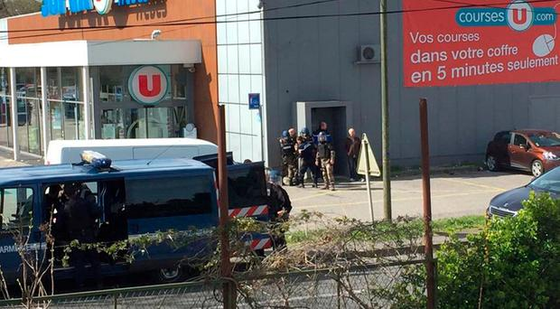 Police are seen at the scene of a hostage situation in a supermarket in Trebes, Aude, France March 23, 2018 in this picture obtained from a social media video. LA VIE A TREBES/via REUTERS