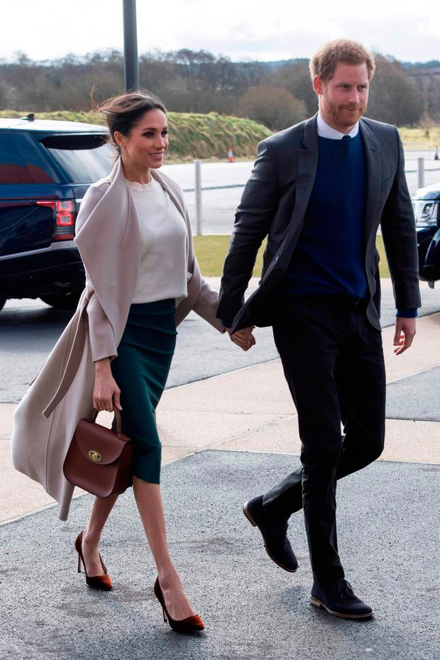 Britain's Prince Harry and US actress and fiancee of Britain's Prince Harry Meghan Markle arrive at the Eikon Centre in Lisburn, on March 23, 2018, to attend an event to mark the second year of youth-led peace-building initiative Amazing the Space. / AFP PHOTO / POOL / ARTHUR EDWARDSARTHUR EDWARDS/AFP/Getty Images