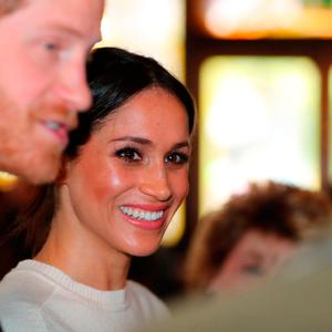 Prince Harry and Meghan Markle during a visit to the Crown Bar in Belfast City Centre where they learnt from National Trust representatives about the pub's heritage, and met bar staff, local comedians and musicians