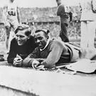 Leaps of faith: Jesse Owens forged a '24 carat' friendship with German 'Luz' Long during the 1936 Berlin Olympics as they competed in the long jump - Owens took the gold medal, while Long took silver in the event