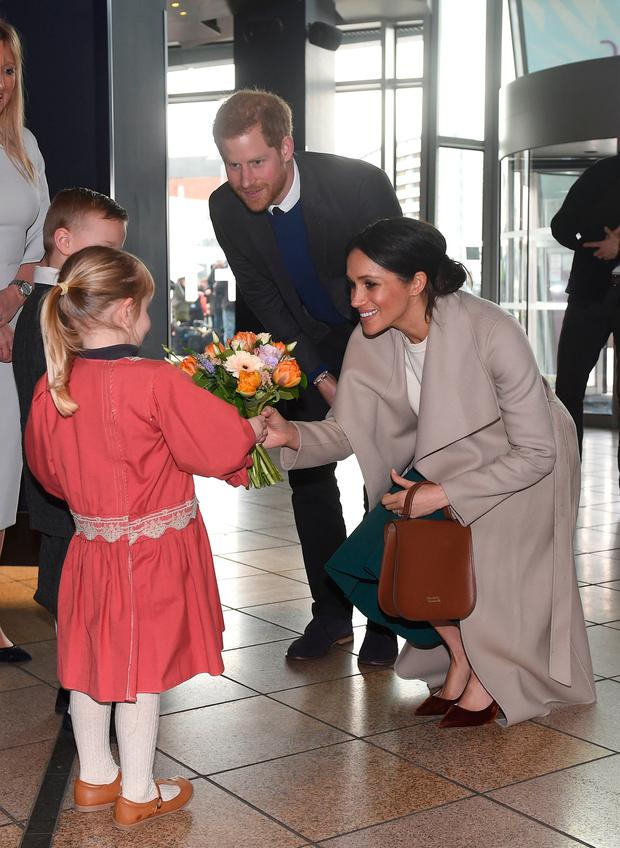 Prince Harry and Meghan Markle are presented with a posey by Lleyton Jackson 6 and Rosie Jackson 4 Photo credit should read: Joe Giddens/PA Wire