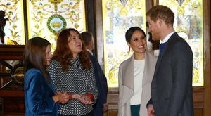Britain's Prince Harry and his fiancee Meghan Markle visit the Crown Bar in Belfast Photo: Gareth Fuller/Pool via Reuters