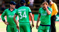 Ireland captain William Porterfield, left, with his team-mates Tim Murtagh, centre, and Barry McCarthy of Ireland dejected