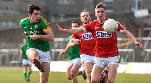 Donal Keogan of Meath in action against Cork's Sean White during the recent Allianz Football League encounter at Páirc Tailteann - both teams have struggled in Division 2 this season. Photo: Oliver McVeigh/Sportsfile