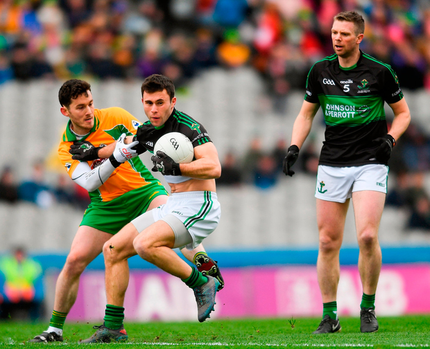 Tomas O Se keeps a watchful eye as Stephen Cronin of Nemo Rangers is tackled by Corofin's Ian Burke the All-Ireland club final last weekend. Photo: Eóin Noonan/Sportsfile